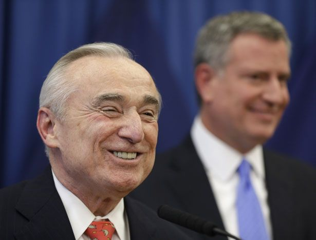 William-Bratton-left-smiles-while-New-York-mayor-elect-Bill-de-Blasio-looks-on-during-a-news-conference-in-New-York-Thursday-Dec.-5-2013.-AP-Photo