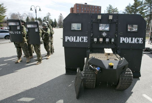 pPolice-stand-next-to-a-SWAT-robot-in-Sanford-Maine-during-a-media-demonstration.-AP-PhotoRobert-F.-Bukatyp