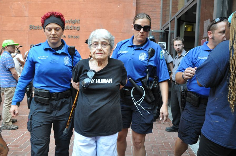pemSt.-Louis-Metropolitan-Police-officers-escort-Hedy-Epstein-a-90-year-old-Holocaust-survivor-after-arresting-her-for-failure-to-disperse.-Photo-by-Steven-Hsiehemp