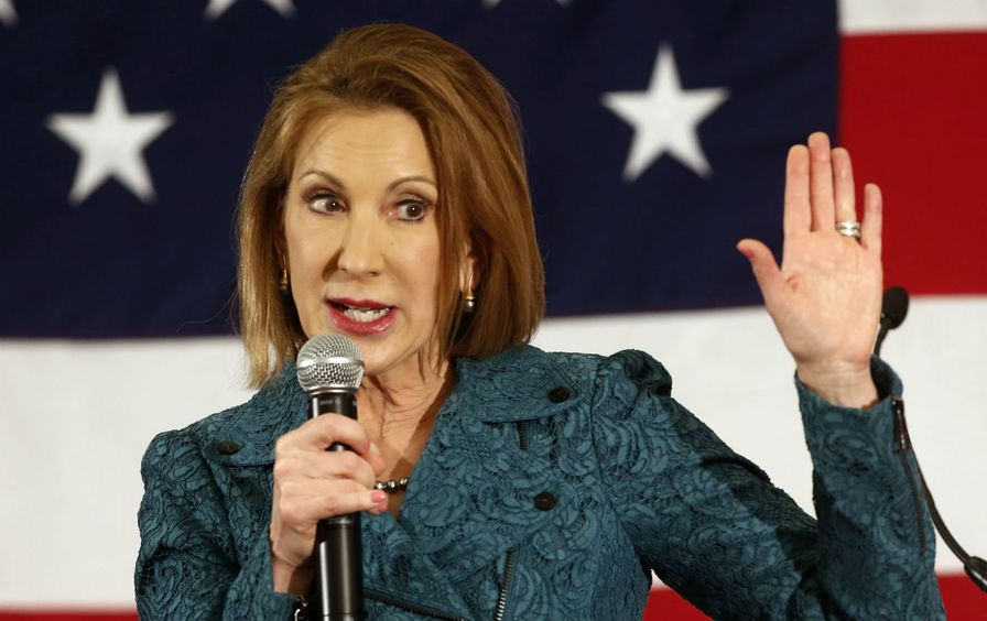 Carly Fiorina with her hand raised at the Republican Leadership Summit in Nashua, NH.