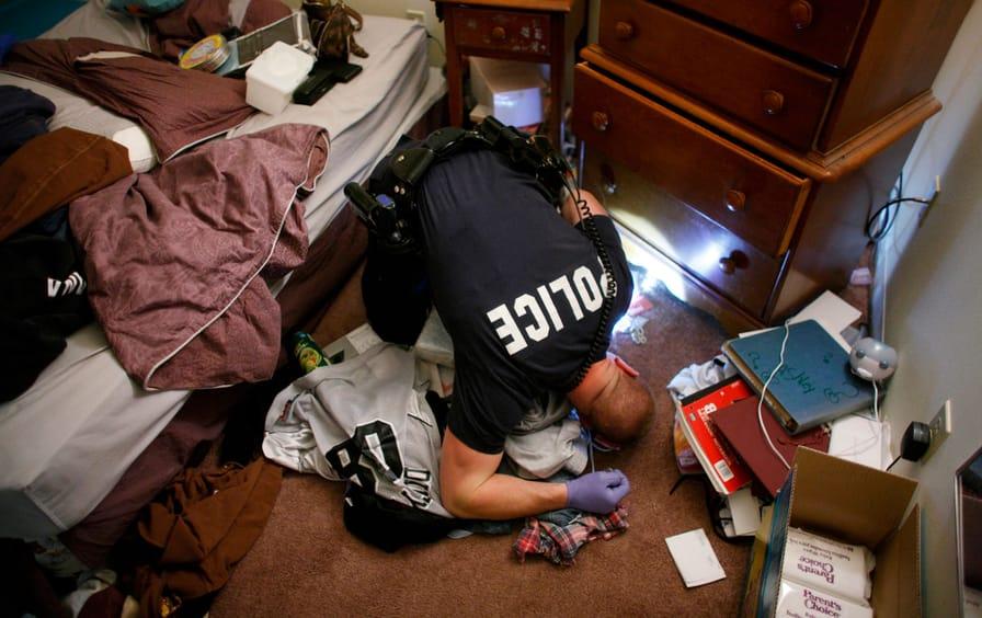 Search and seizure: A drug bust in Kalamazoo, Michigan, November 12, 2009. (Credit: John Gress / Reuters)