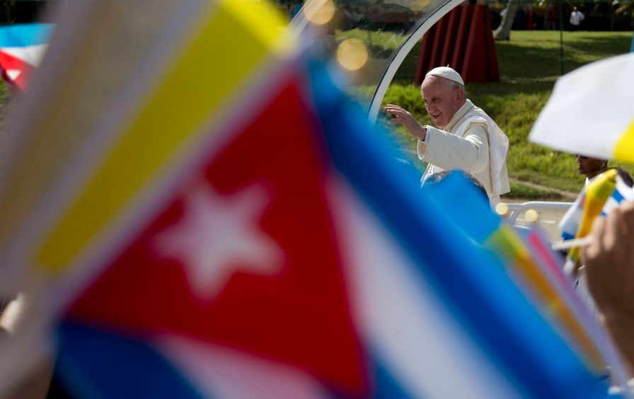 Pope Francis waves from his popemobile as he arrives to celebrate Mass at the Plaza of the Revolution in Holguin, Cuba