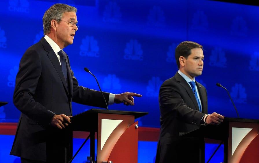 Jeb Bush speaks as Marco Rubio looks on during the October 28 Republican presidential debate.
