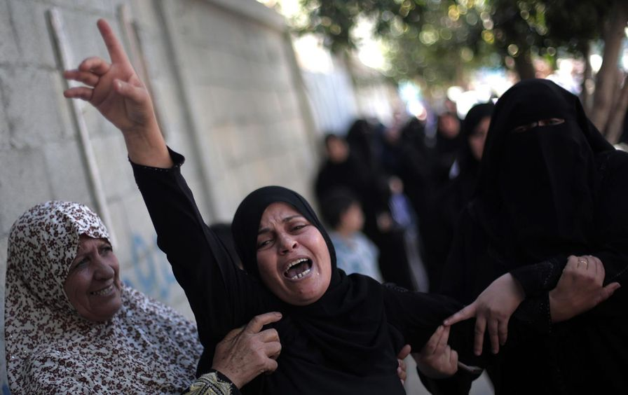 Palestinian women mourn at the funeral of Ahmed Al-Serhi, 27, who was killed during clashes with Israeli troops.