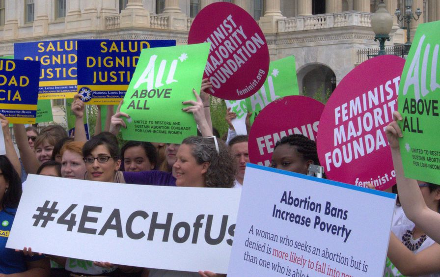 Activists gather as politicians introduce the EACH Woman Act