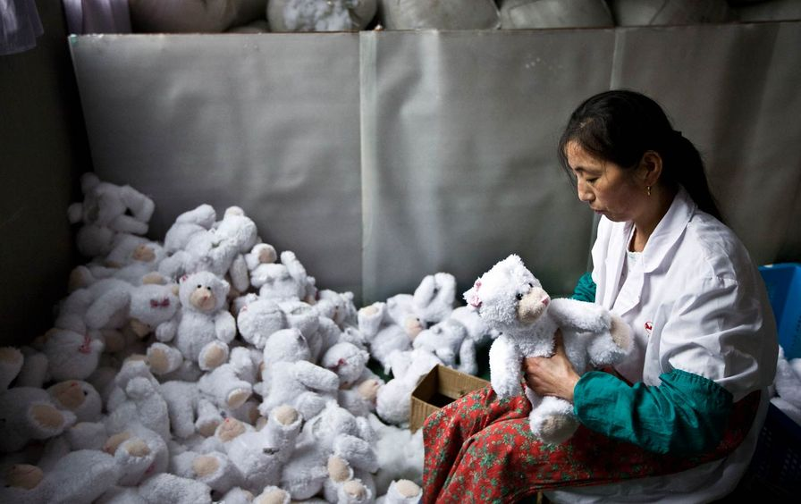 A worker stuffs newly made toys at the production line of a factory in suburban Shanghai.