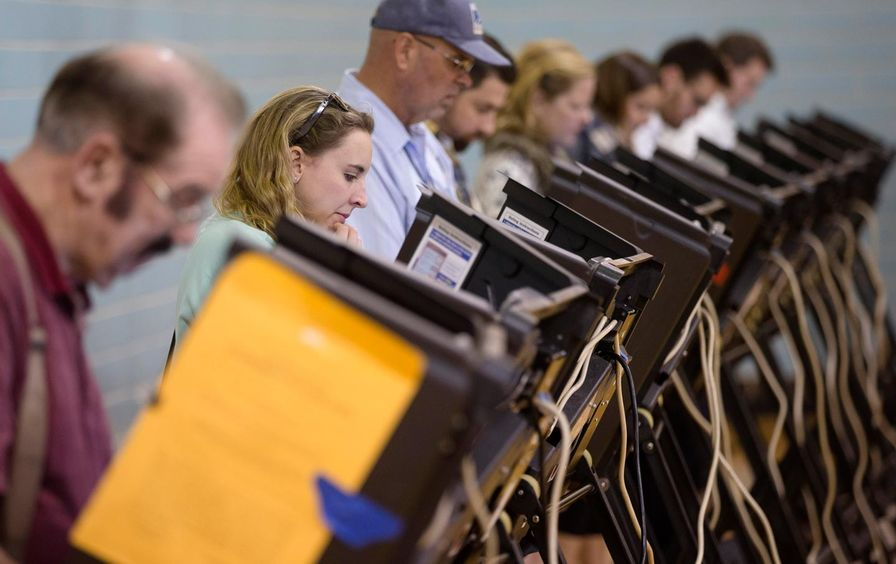 Voters use electronic voting machines on election day, Tuesday, November 3, 2015, in Columbus, Ohio.