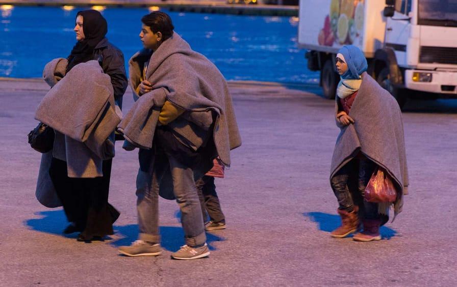 Refugees arrive by boat in Athens, December 18, 2015.