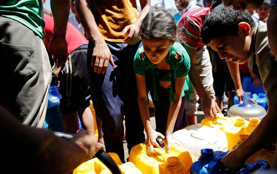 Palestinian child collecting water
