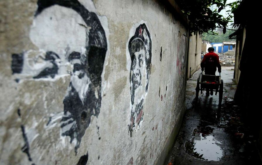 Worn portraits of Mao Zedong in Shanghai, China, 2006.