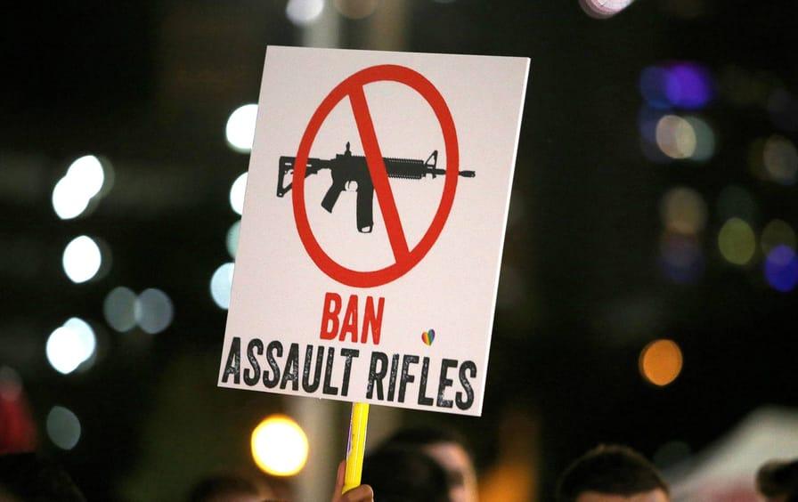 A sign calling to ban assault rifles
