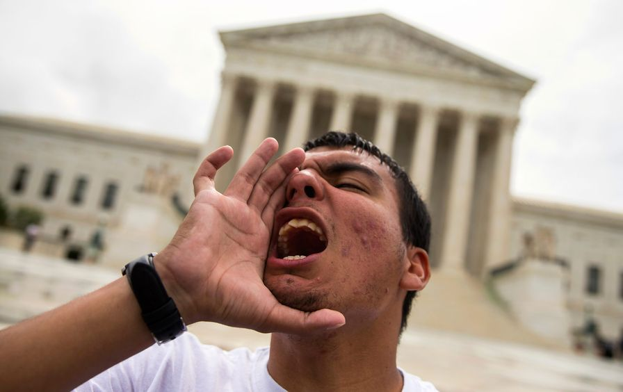 A young man yells during a demonstration at the Supreme Court
