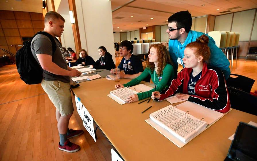 High school students work the polls