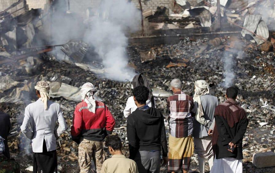 Civilans look at rubble from Saudi airstrike