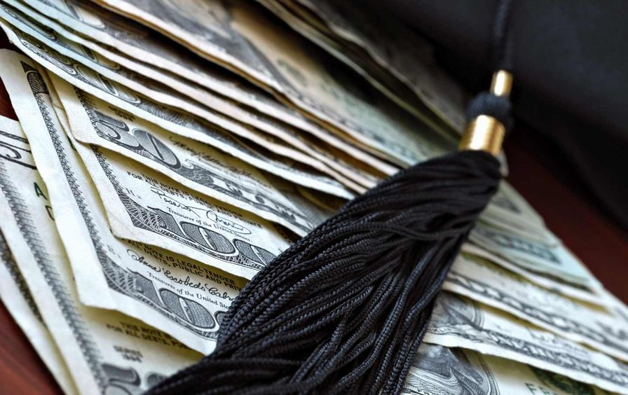 Dollars and graduation cap