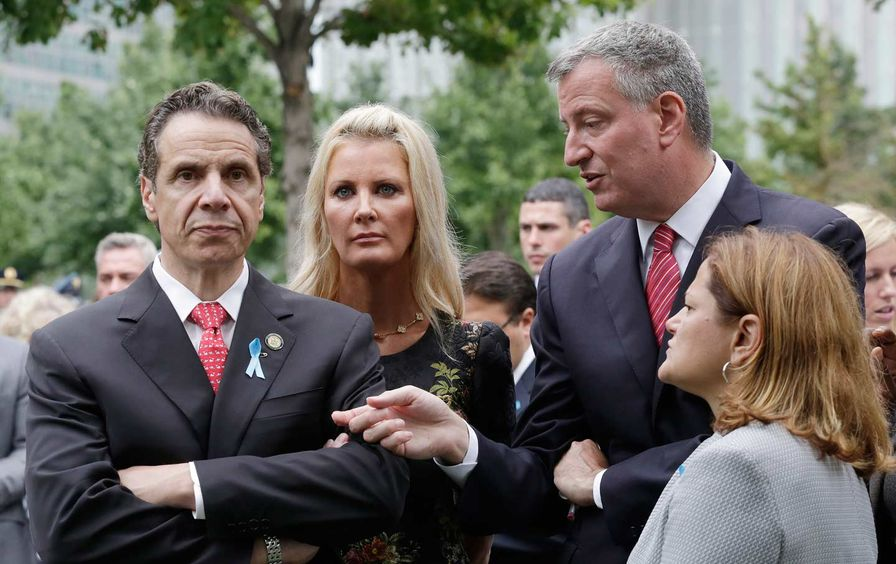Cuomo looking angry, de Blasio trying to talk to him