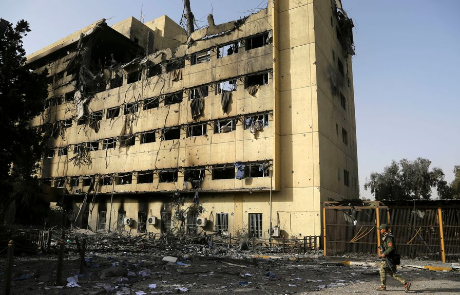Iraqi Soldier by Gutted Iraqi Hospital