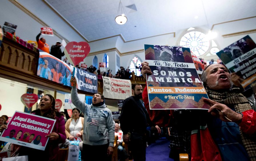 Immigrant rights advocates rally against President Donald Trump