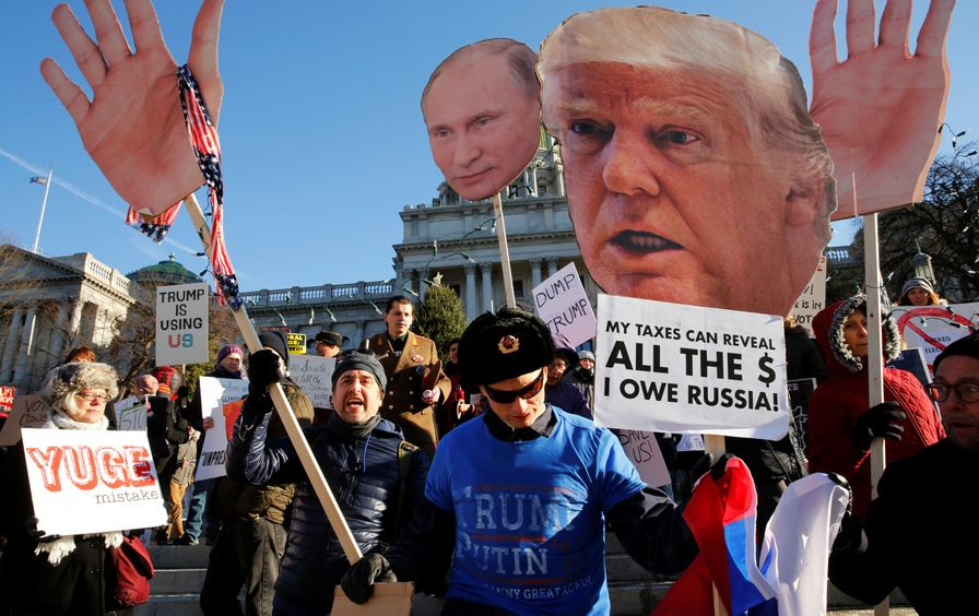 People protest after Russian hacking allegations.