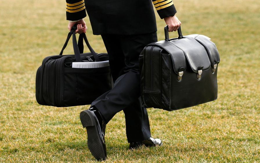A military aide, carrying the