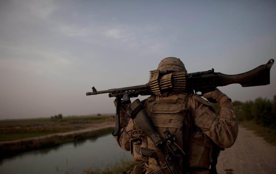 Marine walks in Afghanistan