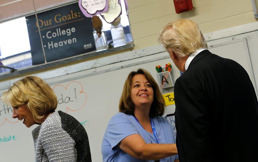 DeVos and Trump visit private schools