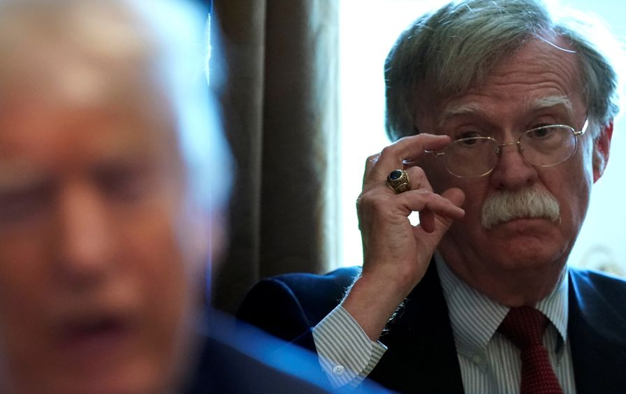 John Bolton at a cabinet meeting with Donald Trump