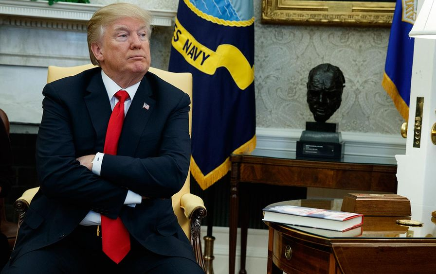 Trump with arms crossed