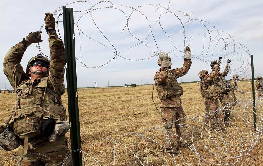 border troops string barbed wire