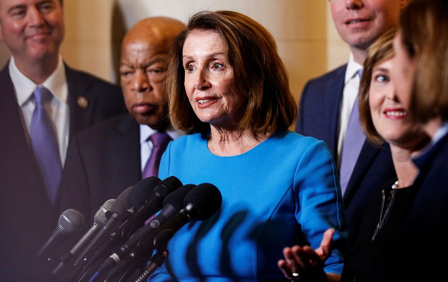 House Minority Leader Nancy Pelosi (D-CA) speaks during a break in a House Democratic Caucus meeting where she was nominated to be Speaker of the House for the 116th Congress on Capitol Hill in Washington