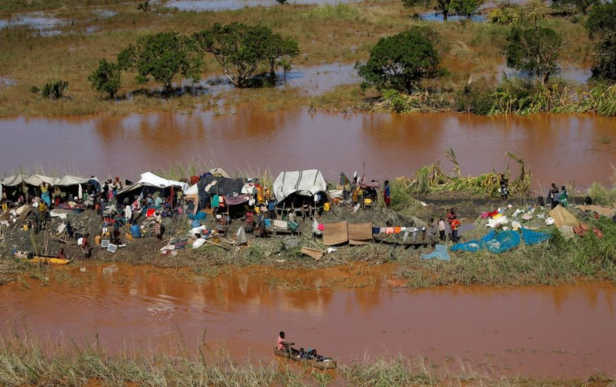Stranded locals look on during floods after Cyclone Idai, in Buzi district, outside Beira