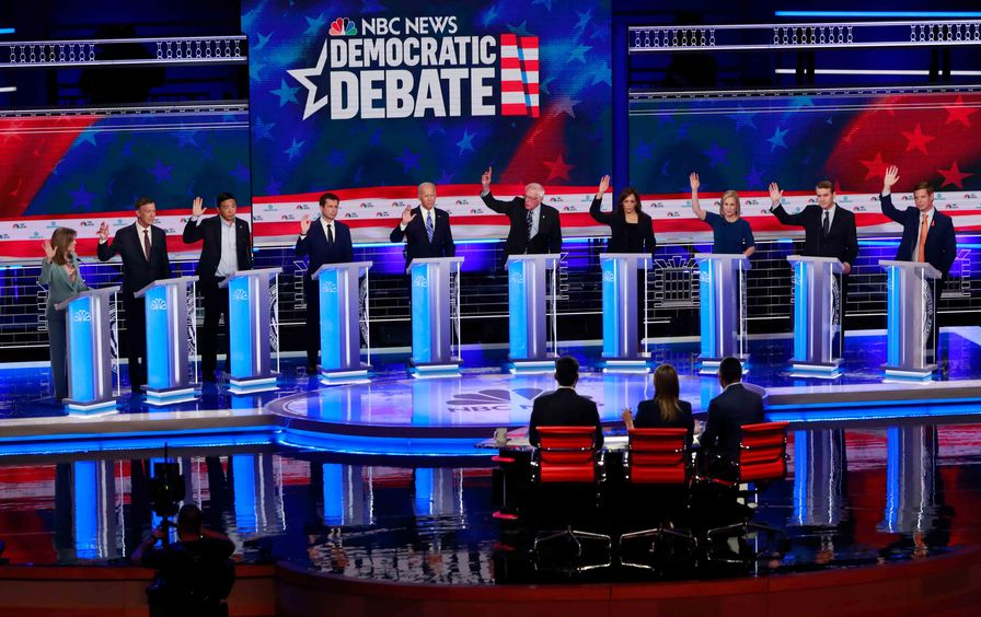 Democratic presidential candidates raise their hands