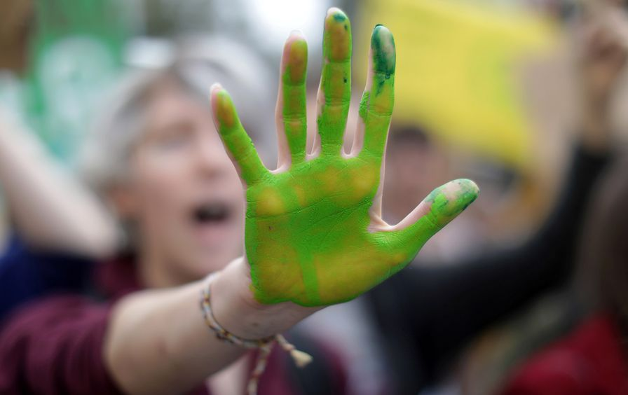 climate-change-protest-hand-img