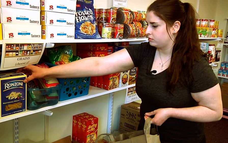 Student at a campus food pantry