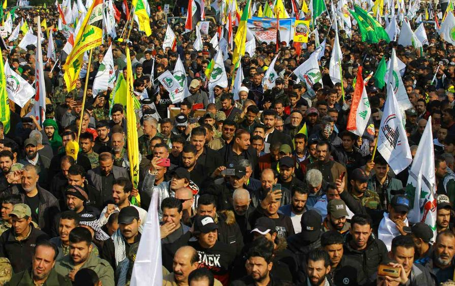 Mourners attend a funeral procession for Suleimani and al-Muhandis.