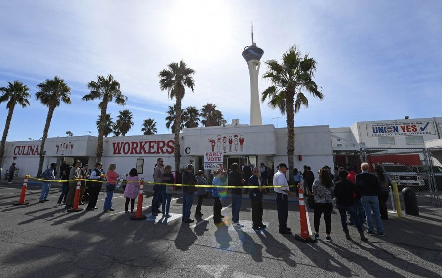Voters line up outside the Culinary Workers Union Hall in Las Vegas