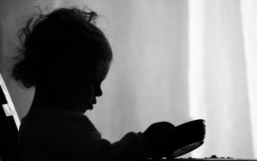 Girl Stares at Empty Bowl