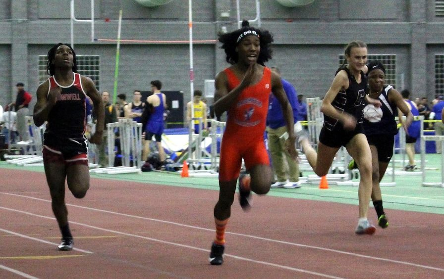 Bloomfield High School athletes Terry Miller, second from left, and Andraya Yearwood, far left, compete in the 55-meter dash at the Connecticut girls Class S indoor track meet in New Haven, Connecticut, February 2019.