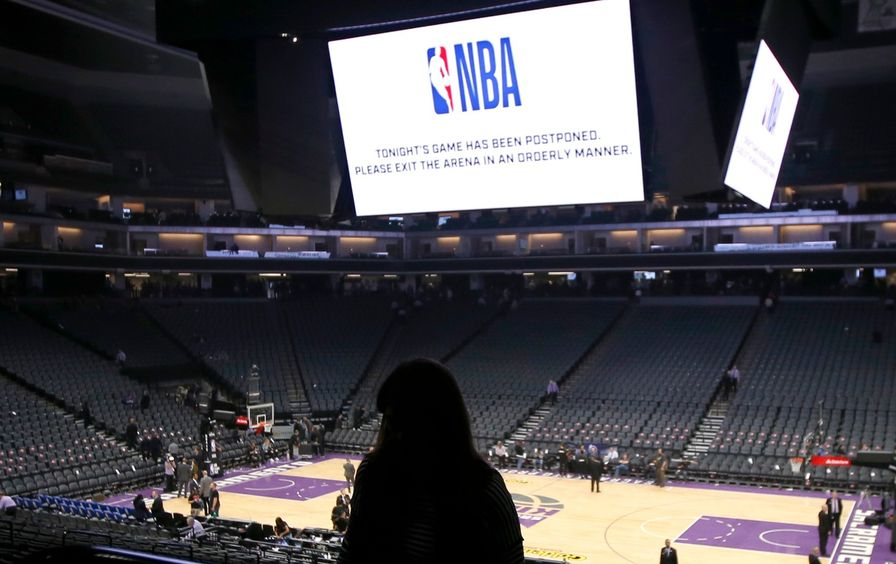 Fans leave after NBA game is cancelled