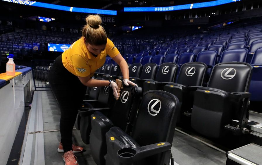 A worker cleans seat after Covid-19 cancellation
