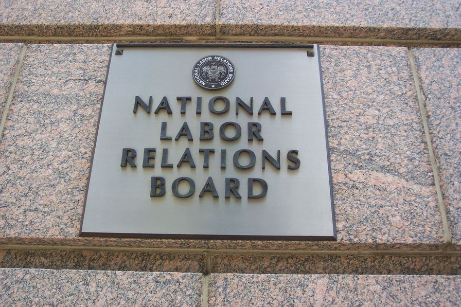 A sign on a building reads: National Labor Relations Board