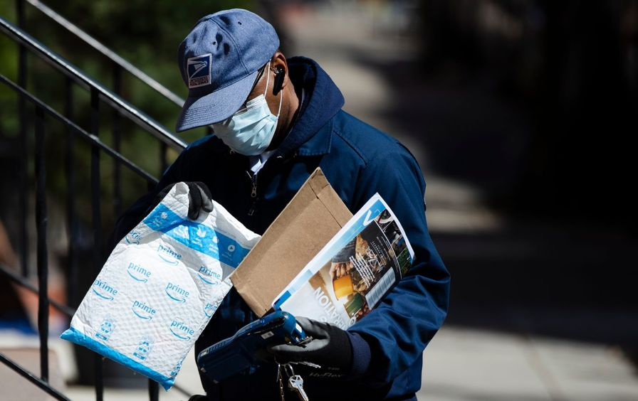 A postal worker making a delivery