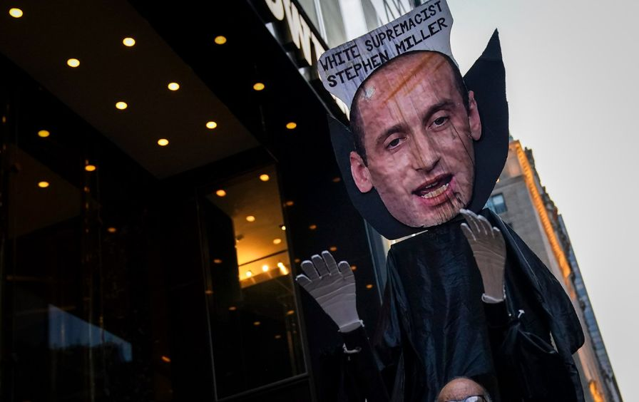 A large effigy of Stephen Miller that reads