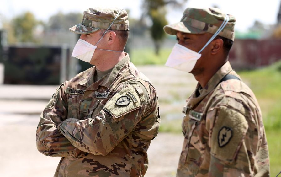 US forces wearing protective gear on an air base
