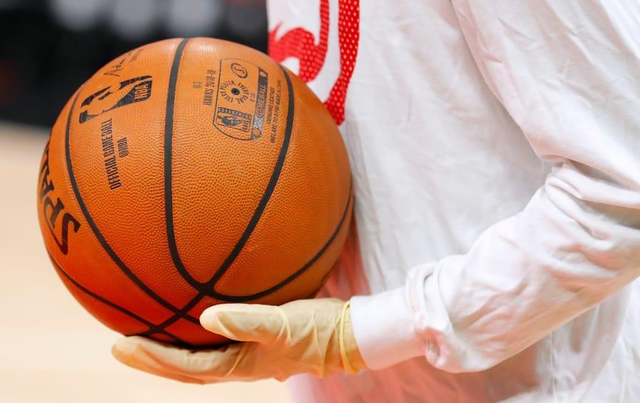 NBA ballboys wear gloves