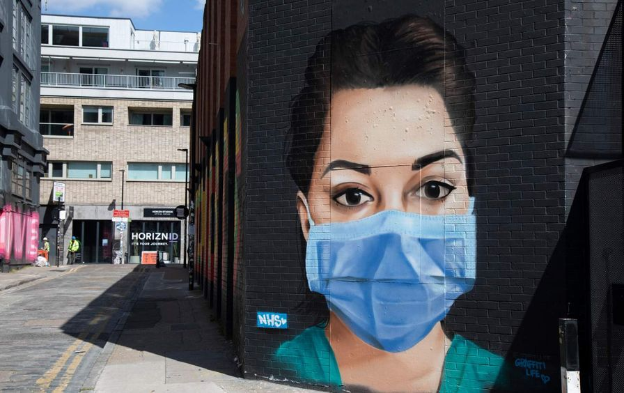Street mural of a nurse wearing a mask