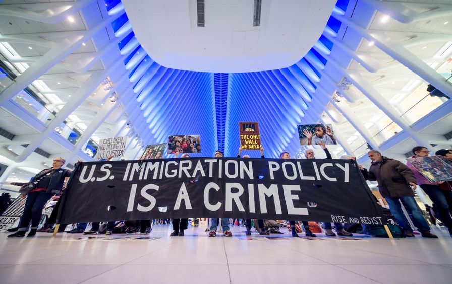 Activists hold a banner that reads