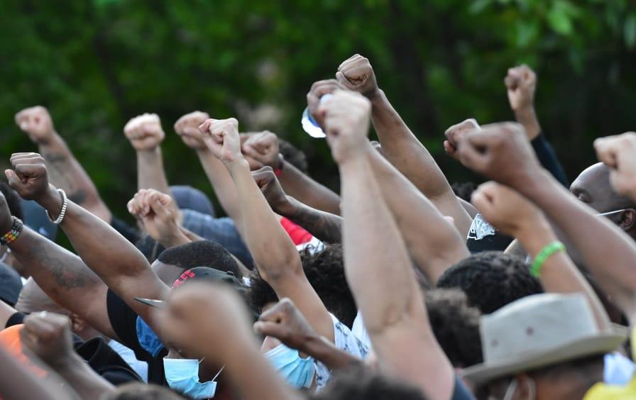 People Raise Fists at George Floyd Rally