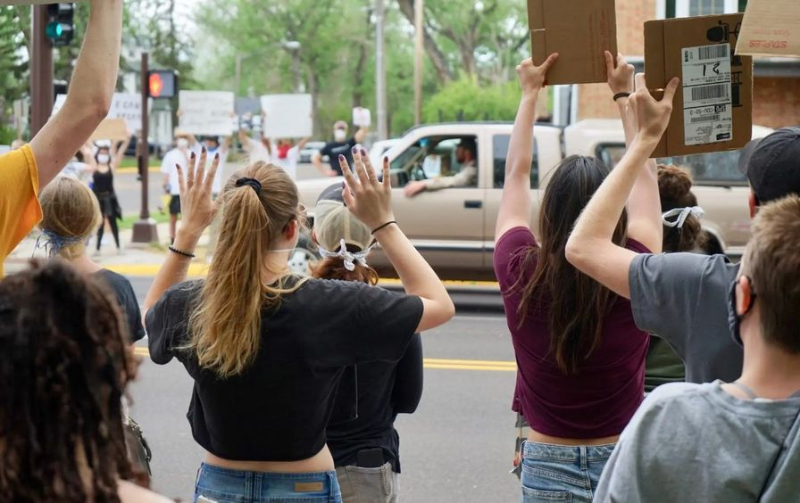 Protesters holding up their hands