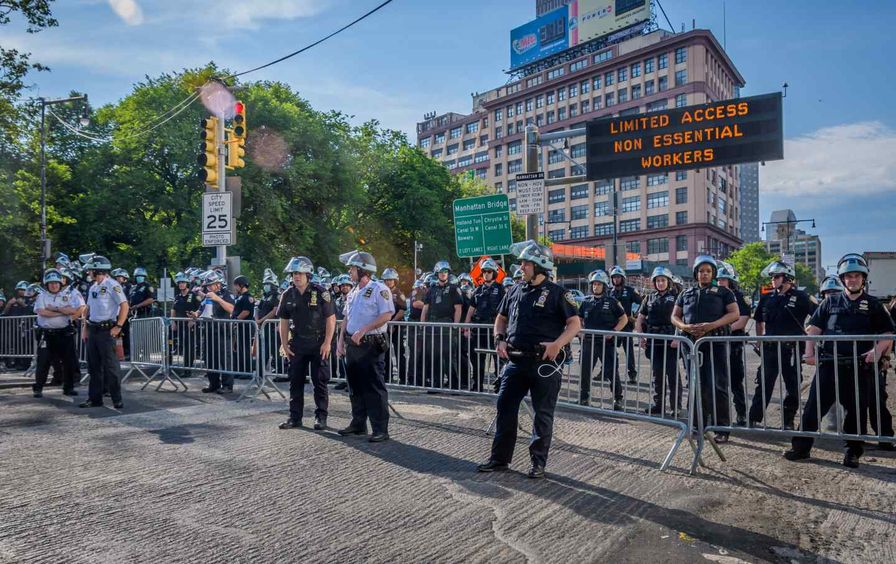 NYPD officers line bridge in riot gear